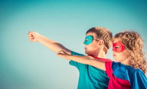 A Little Boy And Girl With Superhero Capes And Masks On