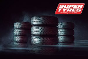 Super Tyres Image With 3 Stacks Of Tyres and The Super Tyres Logo